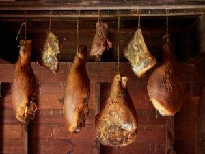 Hams hanging in smokehouse