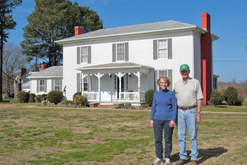 Brenda and Moyler Pond in front of historic home place