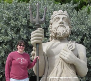 Alisande holding the trident of Neptune at the National Museum of Bermuda.